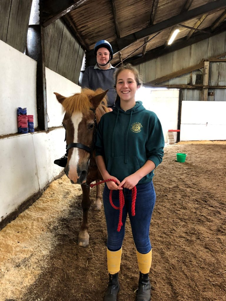kid-on-horse-with-instructor
