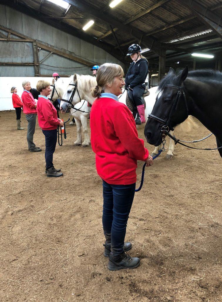 kids-on-horse-side-shot